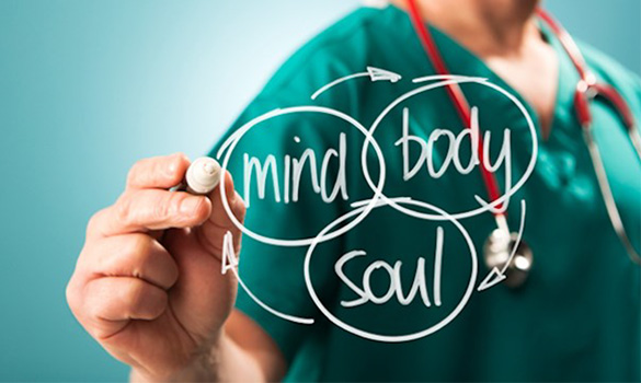 clinician or doctor wearing scrubs writing mind body soul on a transparent board - victory addiction recovery center - lafayette louisiana drug and alcohol addiction treatment facility - alcohol detox - iop inpatient rehab