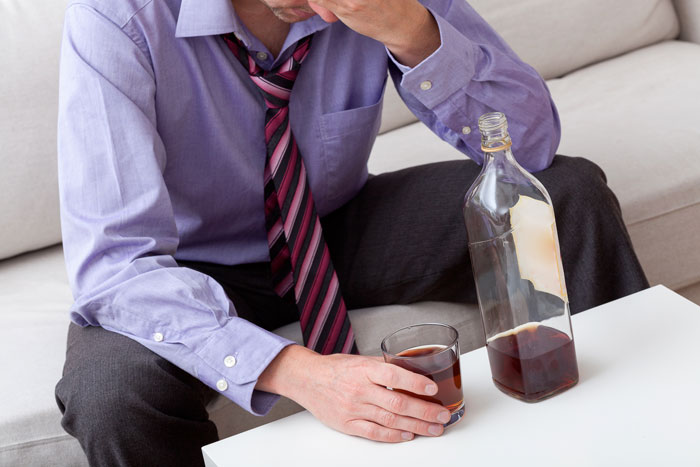 warning signs of alcoholism - victory addiction recovery center - man drinking