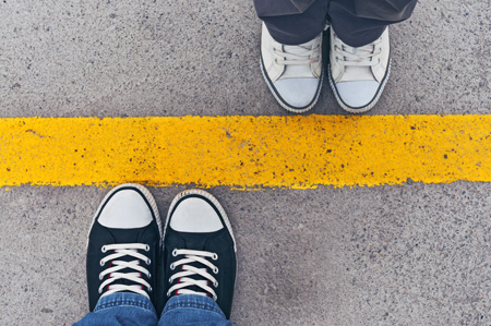 setting boundaries in sobriety - top view of shoes at line - victory addiction recovery center