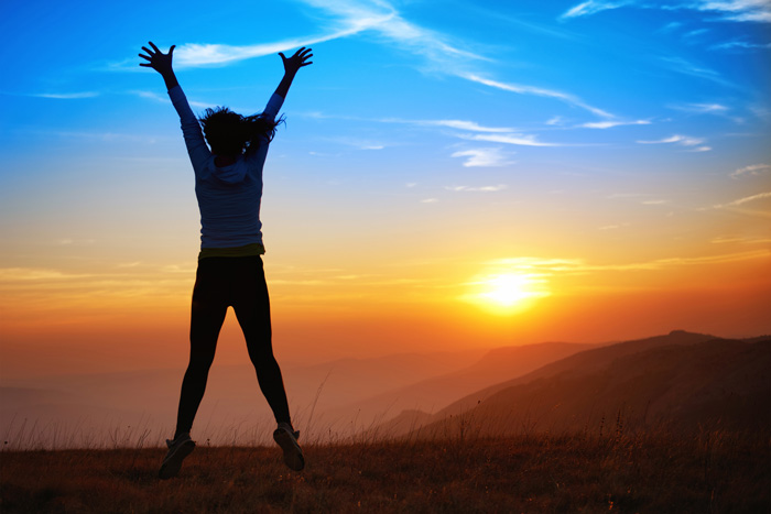 sobriety is awesome - happy woman at sunset - victory addiction recovery center