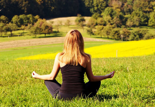 stress management in addiction recovery - woman doing yoga - victory addiction recovery center